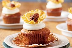 Thes hummingbird cupcakes are similar to a carrot cupcake, but instead of carrots, the batter is studded with diced bananas. Top your cupcake with pineapple flowers, attaching the banana chips and pecan halves with dabs of icing. Photo by Stacey Brandford.