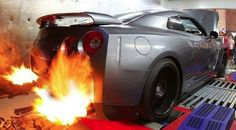 Nissan GT-R with flaming exhausts  http://www.guerrilla-exhaust.com