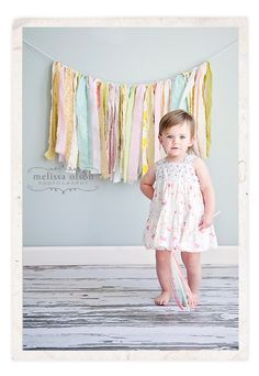 love the simple fabric garland in the background .. this would work for a wedding photo booth too.