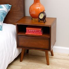 @Overstock.com - Sterling Antique Honey Nightstand - Add a touch of mid-century style to your home decor with the Sterling Nightstand, featuring an inviting antique honey finish. This dresser highlights a 1-drawer, 1-shelf design and a durable rubberwood, MDF, and veneer construction.  http://www.overstock.com/Home-Garden/Sterling-Antique-Honey-Nightstand/7585225/product.html?CID=214117 $149.99