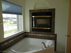 Tub below the fireplace