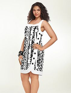 Printed stretch sateen sleeveless dress finished with white edging and black button details. Tulip hem. Hidden back zipper with hook & eye closure. Fully lined. lanebryant.com