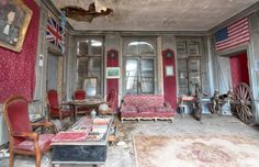 An abandoned property in France with war memorabilia, including a 19th-century cannon. Depicted in far right of image.