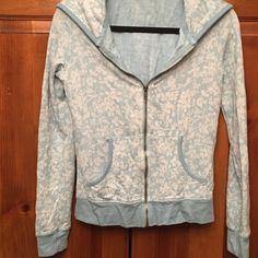 Stylish Floral Patterned Zip-up Hoodie  Stylish Floral Patterned Hoodie with Front Pockets. A turquoise blue color  Jackets & Coats