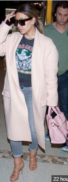 Kim Kardashian: Coat, necklace, and sunglasses – Celine  Purse – Balenciaga  Shoes – Gianvito Rossi