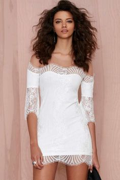 Oh, For Love and Lemons, why are you so good to us? The Belle Mini Dress is made in white lace and has sheer mesh lace panels at bodice.