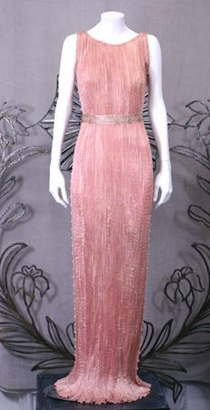 Mariano Fortuny shell pink pleated silk Delphos gown circa 1930. Striated white murano glass bead and silk cord trimmed down side seams and armhole. Silk belt stencilled in silver foliate patterns.
