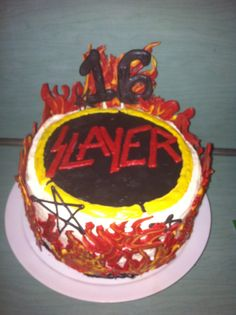 Slayer cake I made for my sons 16th birthday. I iced the cake and made all if the decorations using candy melts!