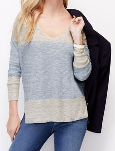 Just because the temps are going up, doesn't mean you should adandon sweaters. Ann Taylor's lightweight Colorblock V-Neck Tunic is light, chic, and flattering. Layer over a crisp white button down and pop the collar. Pair with jeans a jacket for an easy spring weekend look. #sweaterweather #colorblock #lightsweater