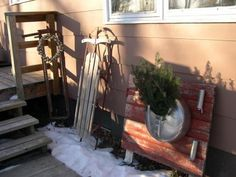 The small door is also from the farm, along with the milk bucket on it. cow stanchion in the corner with wreath