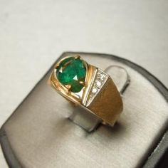 Man's 70's 14kt Yellow Gold Emerald & Diamond Ring Hand Engraved & Florentine Finish  Circa 1970  containing One Pear Cut Genuine Natural Emerald  weighing approximately 2.0 carats  and Three Sincle Cut Genuine Natural White Diamonds  totaling approximately .06 cts.  Ring size 8 1/2 (can be sized)  Weighs 7.9 grams       Item Number:   WS1312