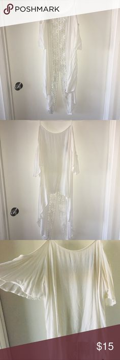 Torrid white lace blouse Preloved 🦋 100% Rayon 🦋 long lace on back of blouse with long tail 🦋 straps with open shoulder sleeves 🦋 bundle to save 10% Tops Blouses