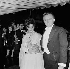 Elizabeth Taylor (in Chanel Haute Couture) and Richard Burton at the Royal Film Performance of 'The Taming Of The Shrew' at the Odeon Theatre. February 27, 1967. Richard Burton Elizabeth Taylor, Royal Films, British Actors, Vintage Chanel, Stock Pictures, Royalty Free Photos, Hollywood, Wedding Dresses, Beautiful
