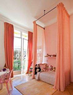 Hang curtains around a child's bed in rooms with many windows!