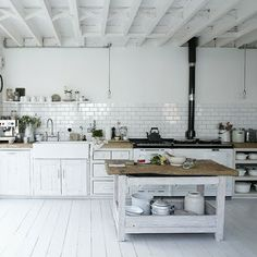 white industrial.  Love the painted white wooden floor (would get trashed in our house though)