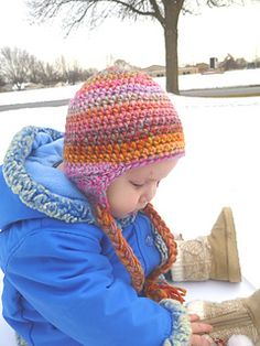 This is a great basic earflap pattern designed to be worked in a continuous round to eliminate an unsightly seam running down the back of the hat. This pattern will be great to use as is or to embellish with character and animal designs. Make it with or without the braids, it looks nice either way.