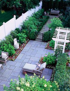 Define your patio with a mixture of shrubs and flowers that will offer an enjoyable variety of foliage and blooms.  (via @Gayle Robertson Roberts Merry Homes and Gardens www.bhg.com)
