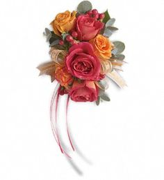 Warm orange and pink roses evoke the splendor of sunset.  A wristlet instead of boquets for bridesmaids?  Hot pink and orange spray roses mingle with red hypericum and accents of Israeli ruscus and eucalyptus.