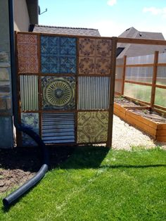 The progress on my corrugated metal fence design and how to build it with wooden posts and rails also using tin ceiling tiles with the corrugated metal. Cheap Privacy Fence, Privacy Fence Designs, Backyard Privacy, Diy Fence, Backyard Fences, Fenced In Yard, Fence Ideas, Privacy Screens, Yard Fencing