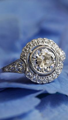 This antique diamond engagement ring is so unique.