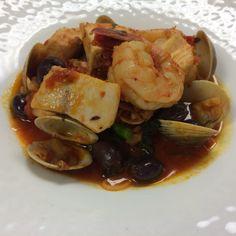 Frutti di mare: swordfish, halibut, clams, shrimp, broccoli rabe, olives, plum tomato sauce, capellini