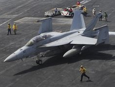 """GULF OF OMAN (June 18, 2013) An F/A-18F Super Hornet assigned to the """"Black Knights"""" of Strike Fighter Squadron (VFA) 154 waits to launch off of aircraft carrier USS Nimitz (CVN 68). Nimitz Strike Group is deployed to the U.S. 5th Fleet area of responsibility conducting maritime security operations, theater security cooperation efforts and support missions for Operation Enduring Freedom. (U.S. Navy photo by Mass Communication Specialist Seaman Apprentice Kelly M. Agee/ Released)"""