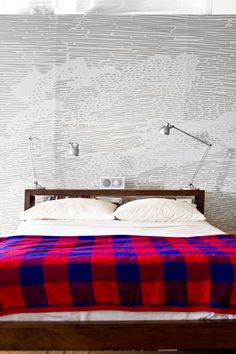 Mural behind the bed: adapted from a scan of a rare book engraving. (I also like the radio and lamps.) (via designsponge*, from Kelli Anderson and Daniel Dunnam's home tour)