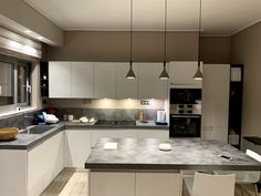 #privateresidence #kalamataproject #concreteplay #foscarinilamps #aplombmini #lamps #design #LucidiPevere #pendantlights #multiple #composition #sophisticated #concentratedbeam #downwards #kitchenarea #kitchen #lightdesign #lightplus #lightplusdesign Lighting Design, Pendant Lighting, Lamps, Composition, Kitchen Cabinets, Retail, Mini, Projects, Furniture