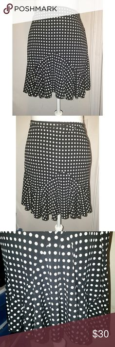 Black & White Polkadot Swishy Summer Skater Skirt Brand: IZ Byer California Size: Marked XL, but larger. At least a 1X. Measurements on request. Style: Long- cut skater skirt with symmetrical flounce panels. Close-up of one panel in pic #3 Fabric: Lightweight, silky, flowing, with a black background covered in tiny white dots - Elastic hem - Fairly unique flounces give the skirt a lot of sway & swing  - Worn & washed a few times, still in like-new condition, aside from the tag being rumpled…