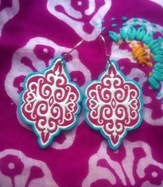 Polymer clay earrings by Shelley Atwood to go with Marketplace India tunic. Earrings were made using Sutton Slice technique with my own stamp design. See more at www.shelleyatwood.com.