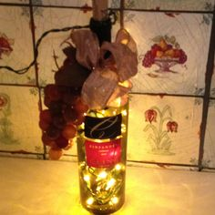 DIY wine bottle gift with Christmas lights in it! Smart!