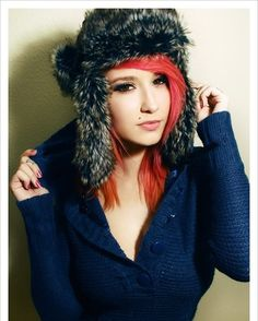 Red hair with orange ends...love the hair and the hat!