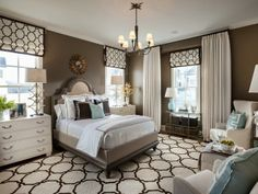 Easily accessible from the main entryway, the master bedroom is a cozy retreat defined by a color palette of chocolate brown and pale blue, traditional style with a modern twist -->  http://hg.tv/v8gn