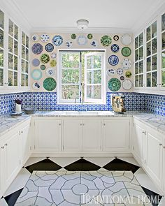 We LOVE the blue-and-white tile backsplash in this pantry. - Photo: Timm Street-Porter / Design: Louise Voyazis