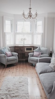 A perfect example of light rustic tones, the calming blue, light grey, and a pop of colour with a blush cushion. All neutral and super chilled topped with a gold chandelier and finished with a white fur rug. Walls are Farrow & Ball Cornforth White. Blog - Madame Mathieu