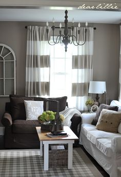 Perfect grayish walls and cute curtains to go with my chocolate brown couch.  Wall color - Cotswald AF-150 by BM, Curtains - stripes painted onto white panels from IKEA via Dear Lillie: Jamie and Josh's New Den