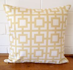 Pale golden yellow and white geometric print cushion cover.  The front and back are made of the same decorating weight, 100% cotton fabric and the cover is closed using a sturdy invisible zip.  This cover measures just under 45 x 45 cm to fit a standard size 18 (45 x 45 cm) cushion insert. Inserts can easily be bought through large craft chainstores or homewares stores.   This cover can be machine washed on a warm gentle cycle and can be ironed using a hot iron.