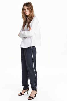 Joggers in a lyocell blend: CONSCIOUS. Joggers in a soft weave in a blend including Tencel® lyocell with an elasticated drawstring waist, side pockets and contrasting colour stripes down the sides.