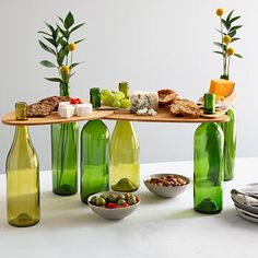 Make picnics more elegant with lightweight, bamboo, midcentry-style tabletops that use full or empty wine bottles as the table legs. Wine Bottle Design, Wine Bottle Art, Glass Bottle Crafts, Diy Bottle, Wine Bottle Cutting, Wine Bottle Fountain, Cutting Glass Bottles, Wine Bottle Planter, Portable Picnic Table