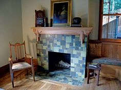 Handmade tile and a custom-made redwood mantel, designed by Michelle Nelson.