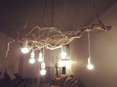 My favourite DIY branch chandelier made by just branches and simple light bulbs. Very low cost.