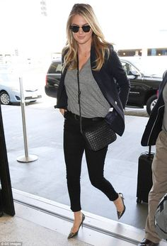 Dressed to impress:The 23-year-old model and actress looked every inch the stylish jet-se...