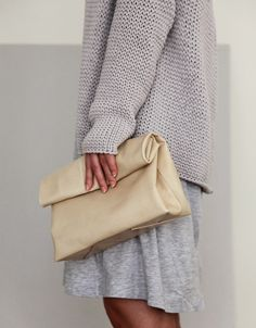 heather grey skirt with over sized grey knit sweater. cream envelope clutch. Classy, casual, modest, and minimal.
