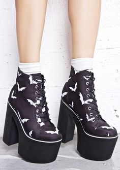 """Current Mood Nightbirds Platforms cuz it'z time to fly away. Yer like a bat in da night with these epic platform boots, with their black canvas construction and creepy cute all over white flyin' bat print. Featuring smooth 'n staggering 6.5"""" heels, 3.25"""" chunky platforms and front lace-up closure."""