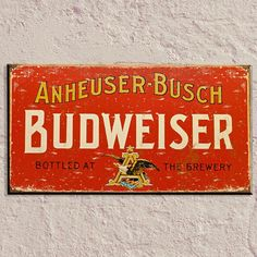 This classic Budweiser sign is a great addition to a home bar or as man cave decor. Add this weathered metal bar sign for a retro look featuring an iconic beer.