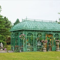 Surrounded by Michigan evergreens, this ornate Victorian-style glass-and-iron conservatory resembles a transparent jewel box showcasing entrepreneur Gina Galvin's of @peacockparkdesign home accessories. Visit our site {link in profile} to see more that is the magic of Peacock Park.