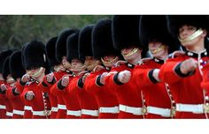 The Grenadier Guards march past Queen Elizabeth II after being presented with their new colours