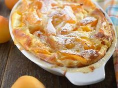 Apricot clafoutis in a baking dish on a rustic table Summer Desserts, No Bake Desserts, Just Desserts, French Desserts, Summer Recipes, Fruit Recipes, Baking Recipes, Dessert Recipes, Apricot Dessert