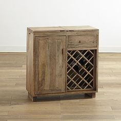 I'm planning to go buy this today, we've been dying for a wine bar and I love the wood on this one. It's just different!