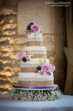Hessian, lace and rose wedding cake and accompanying bride and groom topper